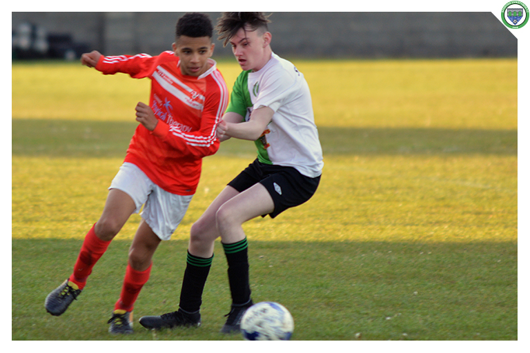 T.J Crowley battles against Newmarket Celtic's number 3 as Sporting run out 3-2 winners in their cup Quarter Final.
