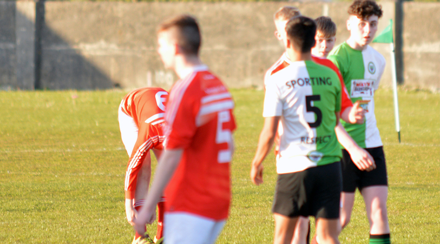 Sporting Ennistymon player's Niall Hogan, Ixim Hernandez and Killian O'Connor shake hands with their Newmarket Celtic counterparts.