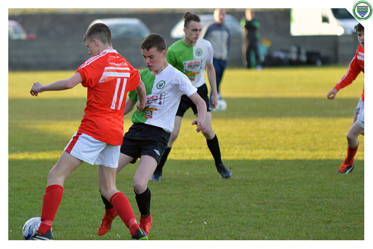 Sporting Ennistymon's Aaron Stackpoole's jersey is dragged by Newmarket's Celtic number 11