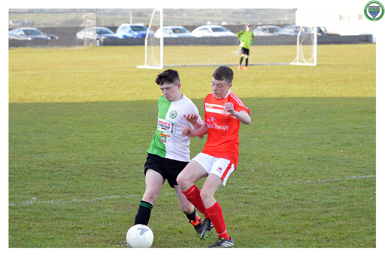 Tommy Crosse battles with Newmarket Celtic's 11 for possession