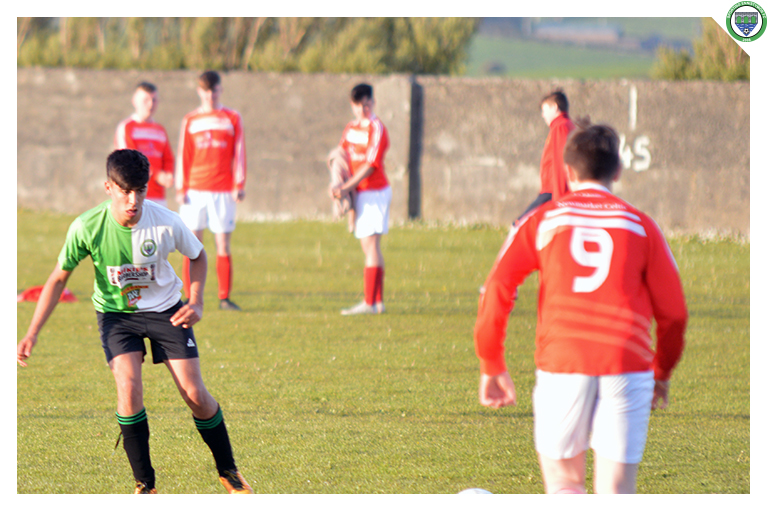 Ixim plays a pass during Sporting Ennistymon's 3-2 cup win against Newmarket Celtic