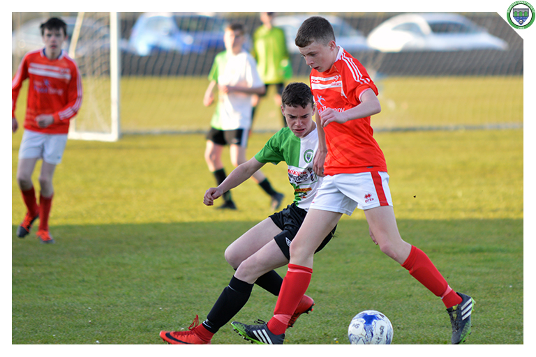 Aaron Stackpoole battles for possession against Newmarket Celtic's 11 in their 3-2 win.