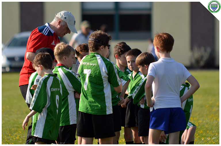 Coach Kieran Griffin speaks to his team of U10's during their entertaining game in the C.B.S Ennistymon pitch.