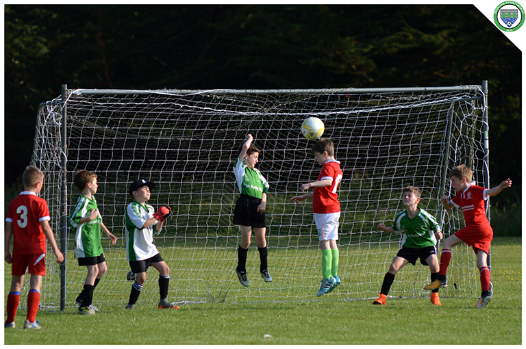 A Newmarket Celtic player is found unmarked in the box and heads over.