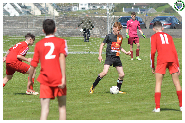 Ciaren Harrington looks to play a pass in the game between Sporting Ennistymon Football Club and Burren United Football Club. Game played on the 25th of August 2018 in Lahinch Sportsfield.