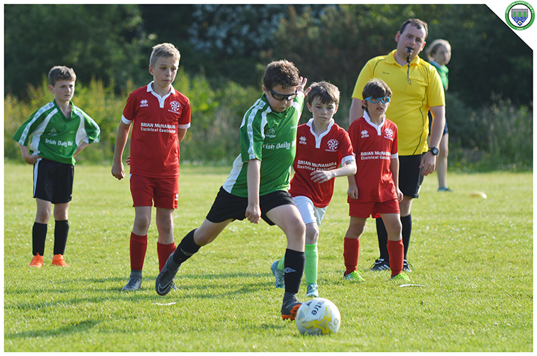 Cian Griffin coolly dispatches a penalty in the U10 game between Sporting Ennistymon and Newmarket Celtic.