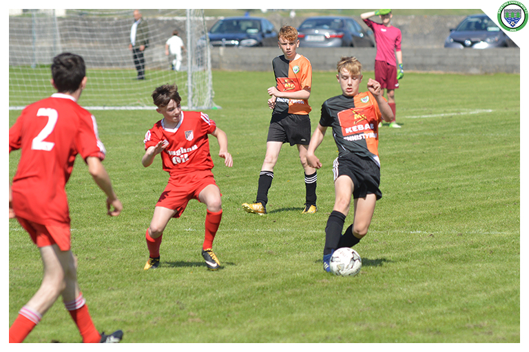 Daithi Fitzgerald attempts to clear in the game between Sporting Ennistymon Football Club and Burren United Football Club. Game played on the 25th of August 2018 in Lahinch Sportsfield.
