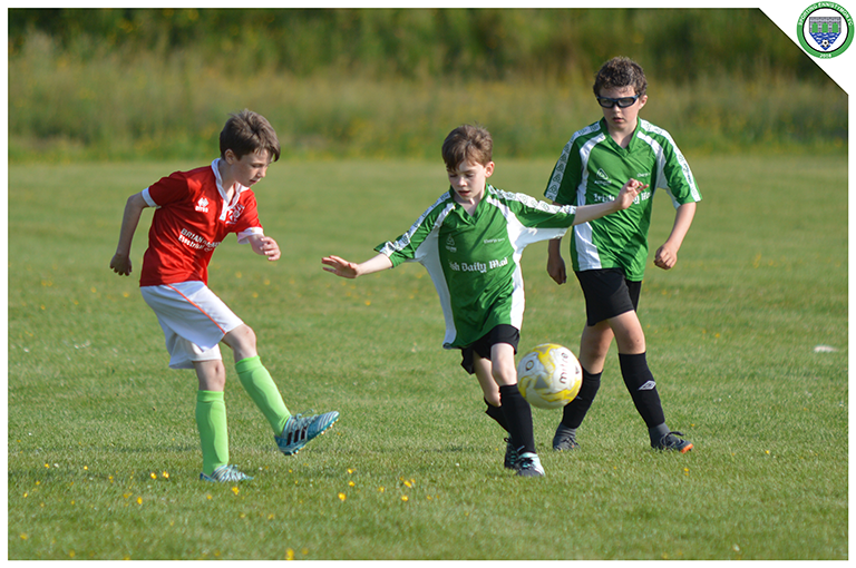 Daniel Keenagh tries to intercept a pass from a Newmarket Celtic player in the game between Sporting Ennistymon and Newmarket Celtic U10's. Game played in C.B.S Ennistymon.