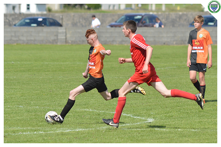 Gavin Burke plays a through ball into the corner in the game between Sporting Ennistymon Football Club and Burren United Football Club. Game played on the 25th of August 2018 in Lahinch Sportsfield.