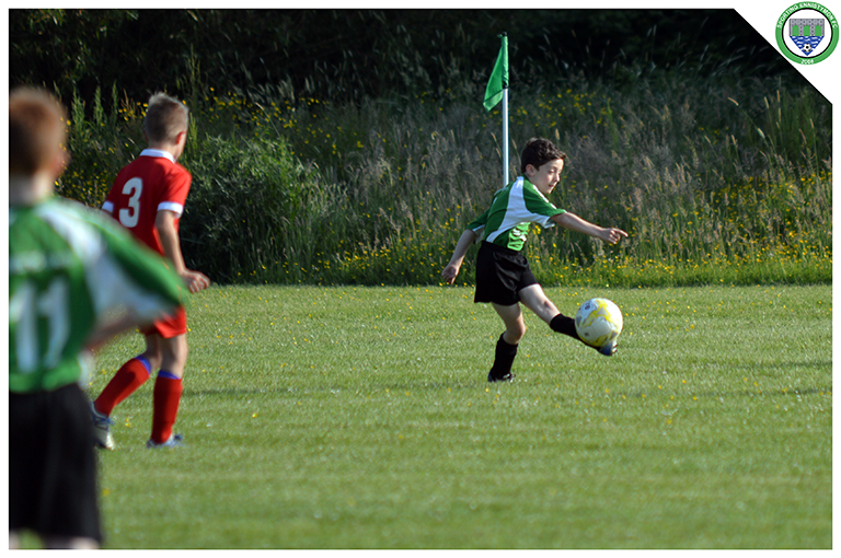 Iwan Phillips clears the ball in the game between Sporting Ennistymon U10's and Newmarket Celtic U10's. Game played in C.B.S Ennistymon.