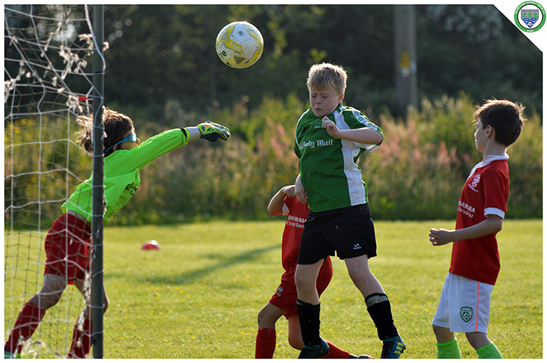 Gearoid Keavy heads into the net as the Newmarket Celtic keeper tries to punch clear. Game played in C.B.S Ennistymon.