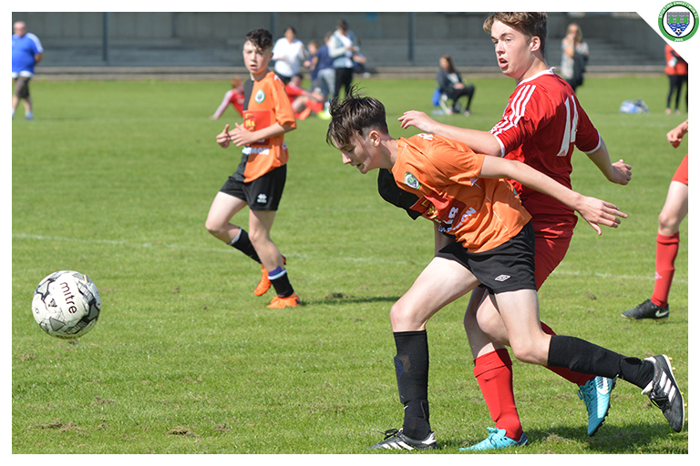 Joe Campbell is tackled by a Burren United player in the game between Sporting Ennistymon Football Club and Burren United Football Club. Game played on the 25th of August 2018 in Lahinch Sportsfield.
