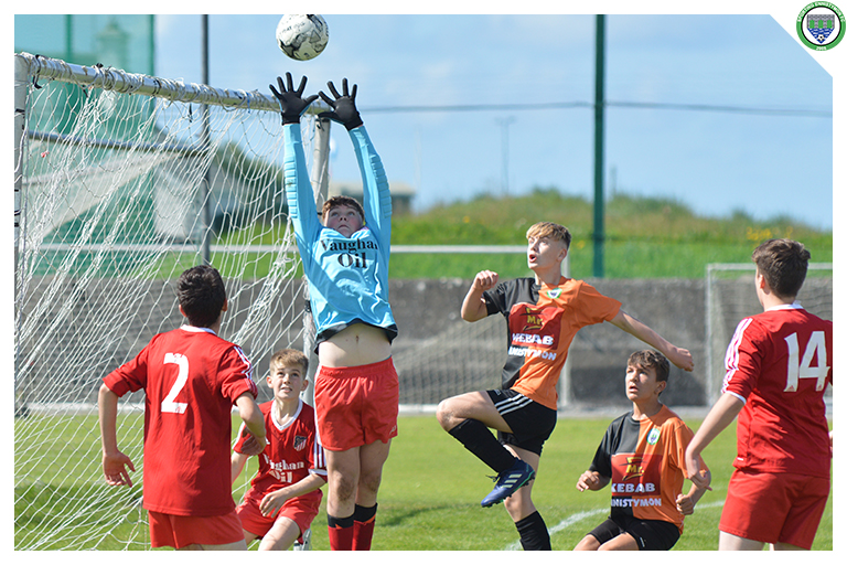 The Burren United keeper jumps highest to catch the ball while Daithi Fitzgerald jumps in an attempt to head the ball into the goal in the game between Sporting Ennistymon Football Club and Burren United Football Club. Game played on the 25th of August 2018 in Lahinch Sportsfield.