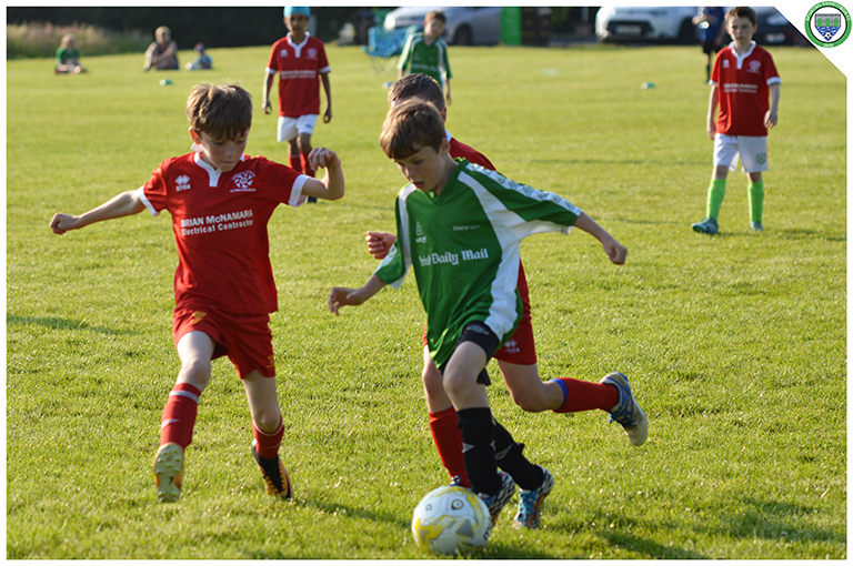 Aidean Hogan takes on Newmarket Celtic players in the game between Sporting Ennistymon U10s and Newmarket Celtic U10s. Game played in the C.B.S Ennistymon.