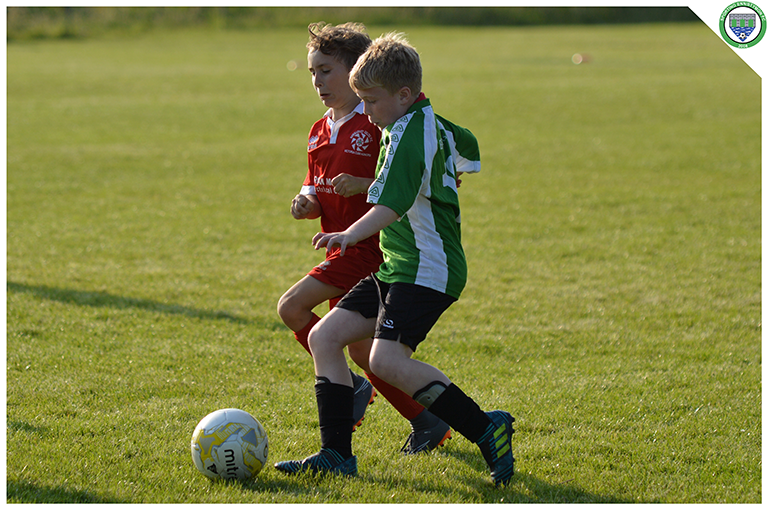 Gearoid Keavey battles for possession in the game between Sporting Ennistymon U10s and Newmarket Celtic U10s. Game played in the C.B.S Ennistymon.