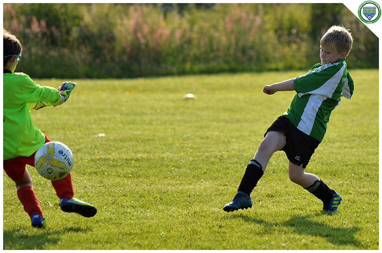 Gearoid Keavy finishes well against the onrushing Newmarket Celtic goalkeeper in the game between Sporting Ennistymon and Newmarket Celtic U10s. Game played in C.B.S Ennistymon.