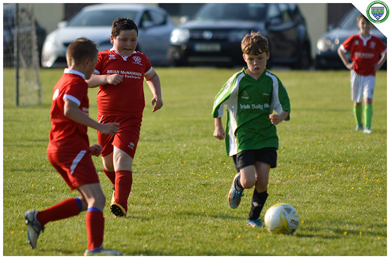 Aidean Hogan takes on Newmarket Celtic players in the game between Sporting Ennistymon's U10s and Newmarket Celtic's U10s. Game played in C.B.S Ennistymon.