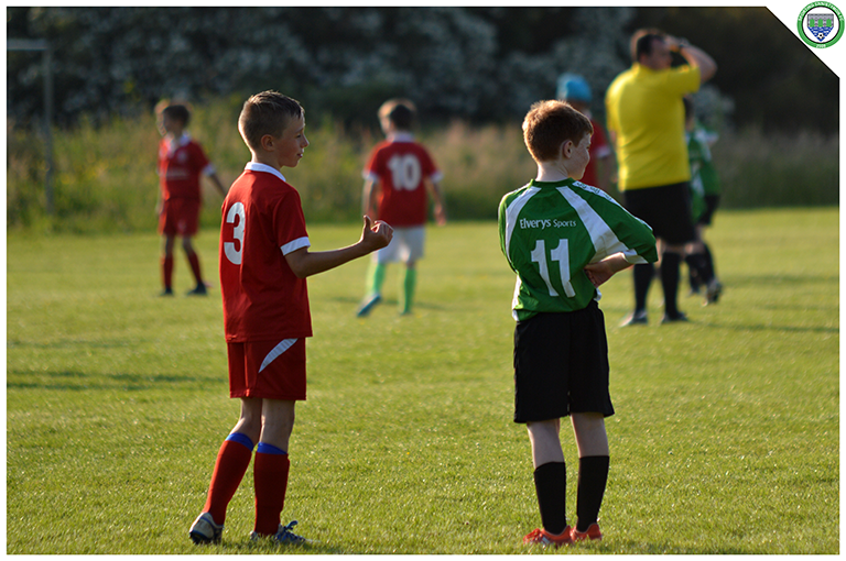 Eamonn Devaney and a Newmarket Celtic player in conversation during the game between Sporting Ennistymon's U10s and Newmarket Celtic's U10s. Game played in C.B.S Ennistymon.