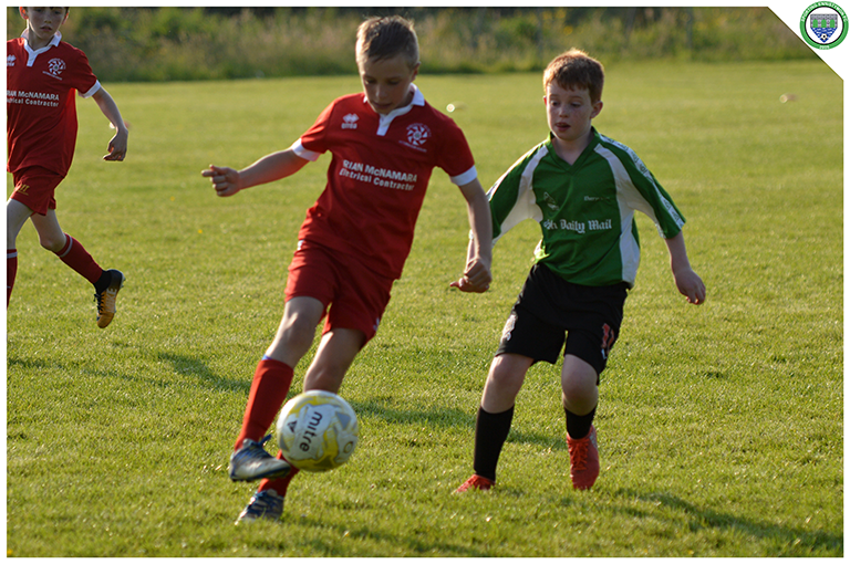 Eamonn Devaney and a Newmarket Celtic player in action during the game between Sporting Ennistymon's U10s and Newmarket Celtic's U10s. Game played in C.B.S Ennistymon.