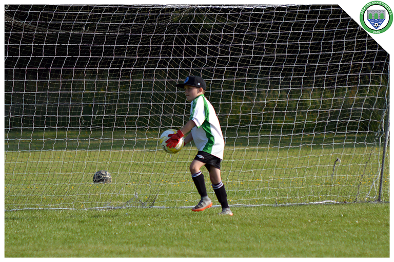 Cathal McNulty throws the ball out in the U10's game versus Newmarket Celtic.