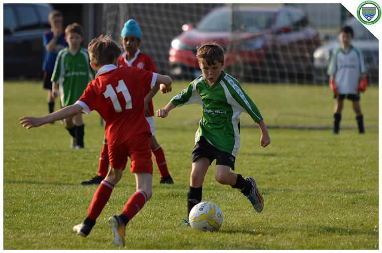 Aidean Hogan takes on a Newmarket Celtic player in the game between Sporting Ennistymon's U10s and Newmarket Celtic's U10s. Game played in C.B.S Ennistymon.