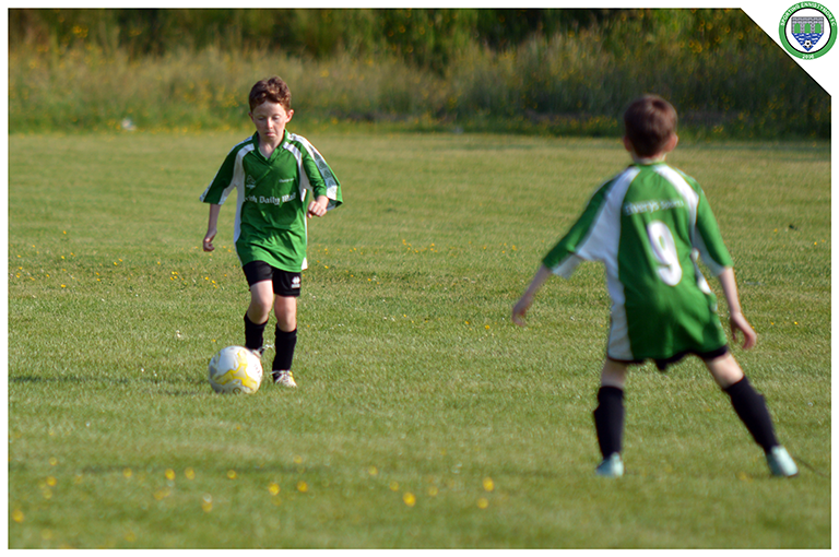 Oisin McCarthy plays the ball out from the back in the U10 game versus Newmarket Celtic in the C.B.S Ennistymon.