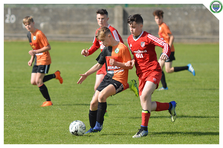 Daithi Fitzgerald shields the ball whilst coming under pressure from a Burren United counterpart in the game between Sporting Ennistymon Football Club and Burren United Football Club. Game played on the 25th of August 2018 in Lahinch Sportsfield.