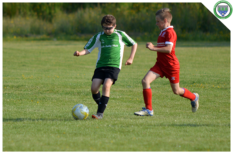 Cian Griffin plays a through ball in the U10's game versus Newmarket Celtic.