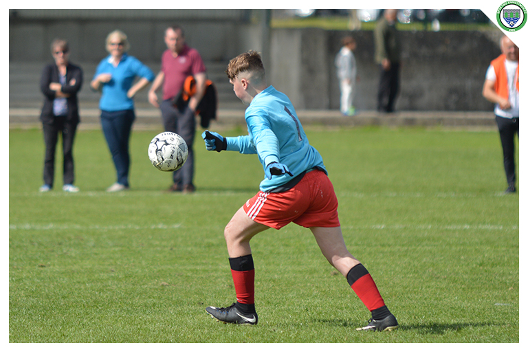 The Burren United keeper kicking out a long ball in the game between Sporting Ennistymon Football Club and Burren United Football Club. Game played on the 25th of August 2018 in Lahinch Sportsfield.