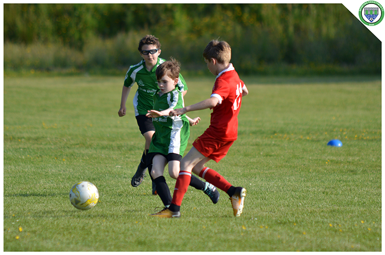 Daniel Keenagh takes on a Newmarket Celtic player in the U10 game in the C.B.S Ennistymon.