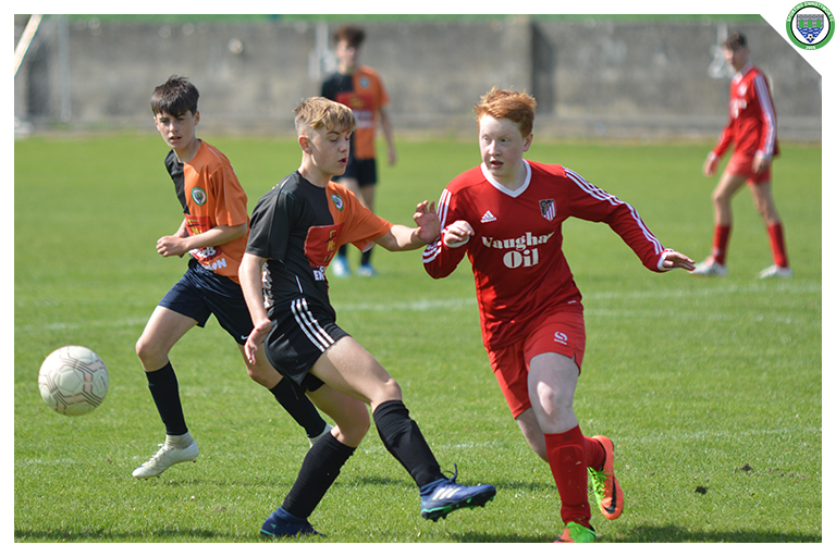 Daithi Fitzgerald attempts to tackle an Burren United player in the game between Sporting Ennistymon Football Club and Burren United Football Club. Game played on the 25th of August 2018 in Lahinch Sportsfield.