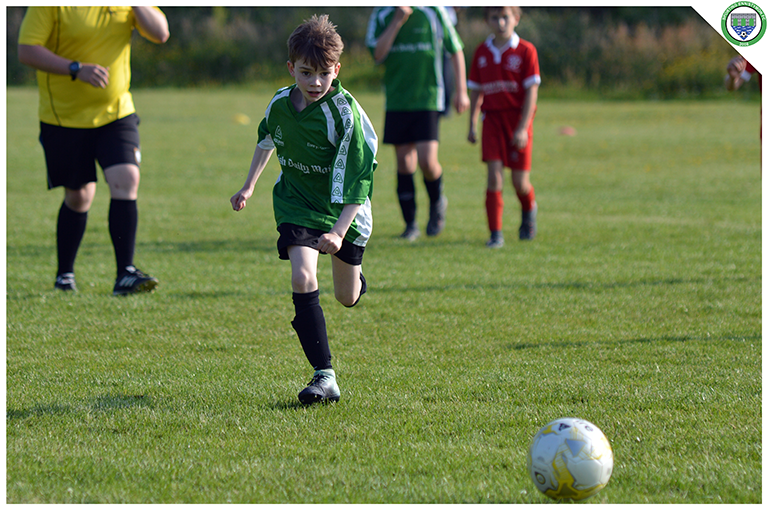 Daniel Keenagh runs on to a through ball in the U10 game versus Newmarket Celtic.