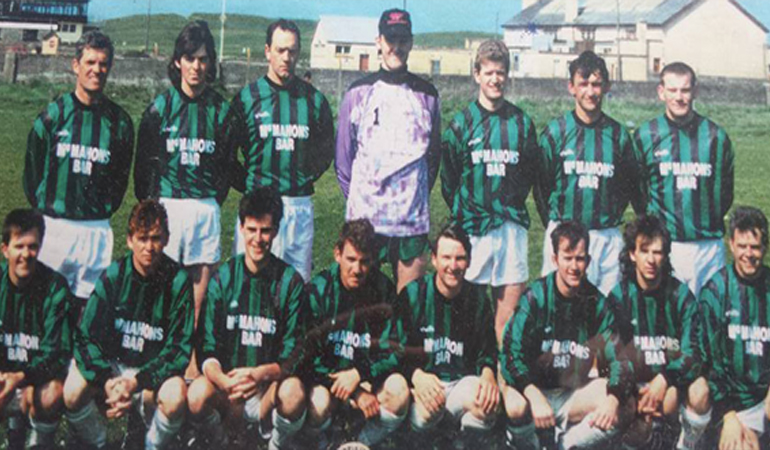 Ennistymon Celtic before playing at home with the old Sluagh Hall in the background.