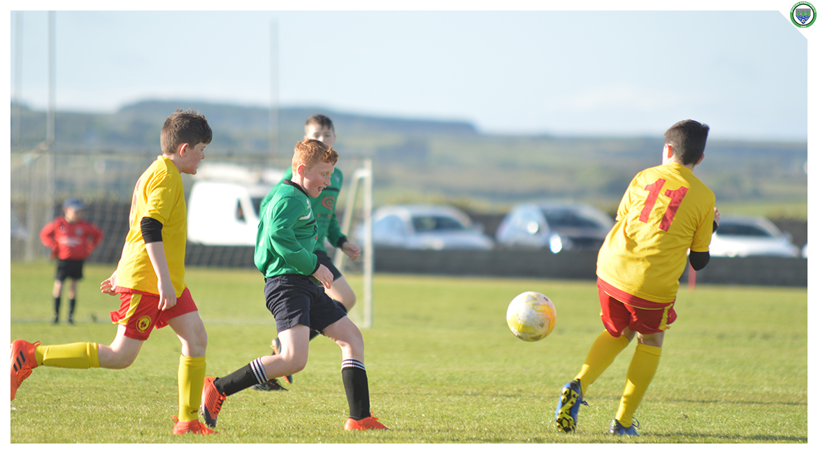 John O'Brien chases down a loose ball in the U12 game between Sporting Ennistymon Football Club and Avenue United Football Club. Game played in Lahinch Sportsfield on the 11th of June 2019.