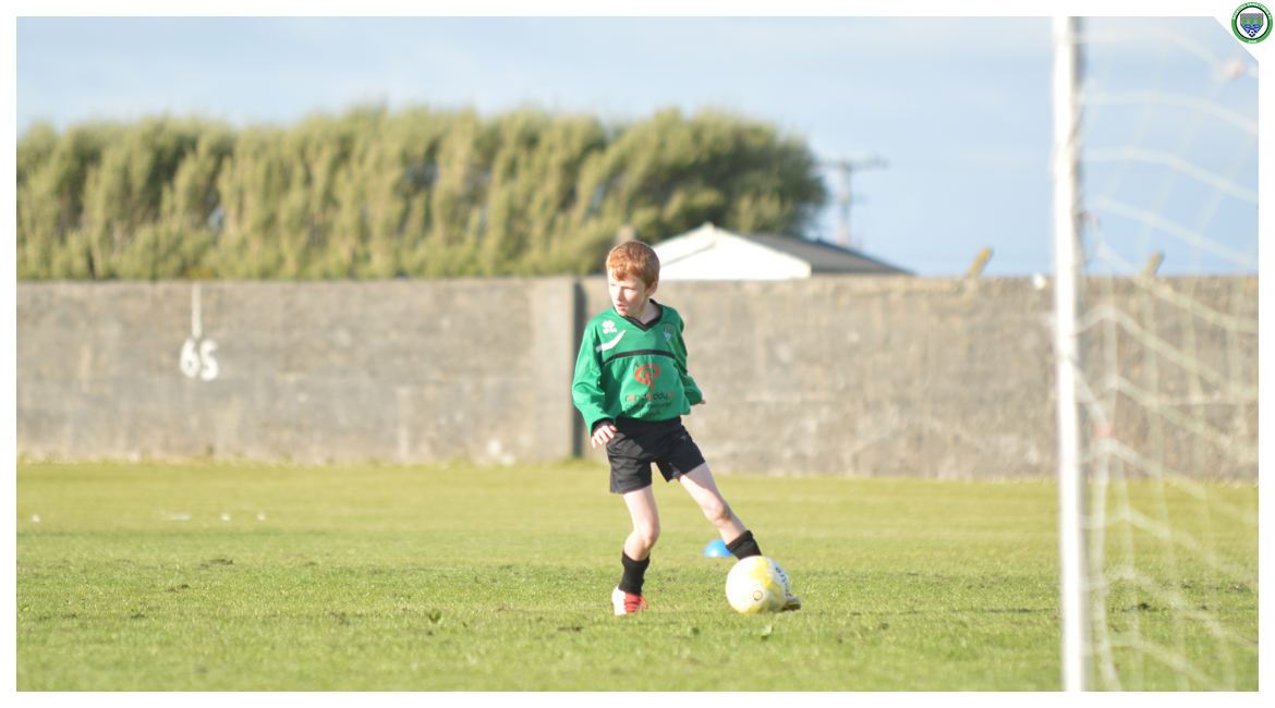 Darren O'Brien holds the ball up in the U12 game between Sporting Ennistymon Football Club and Avenue United Football Club. Game played in Lahinch Sportsfield on the 11th of June 2019.