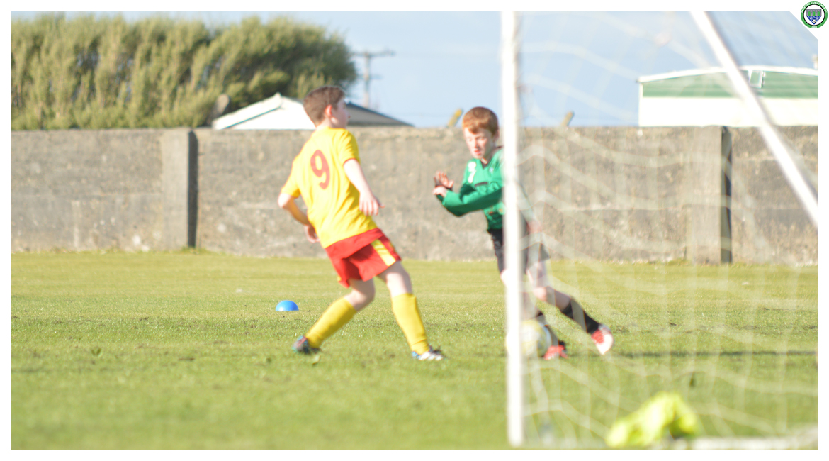 Darren O'Brien holds the ball up while coming under pressure from an Avenue United counterpart in the U12 game between Sporting Ennistymon Football Club and Avenue United Football Club. Game played in Lahinch Sportsfield on the 11th of June 2019.
