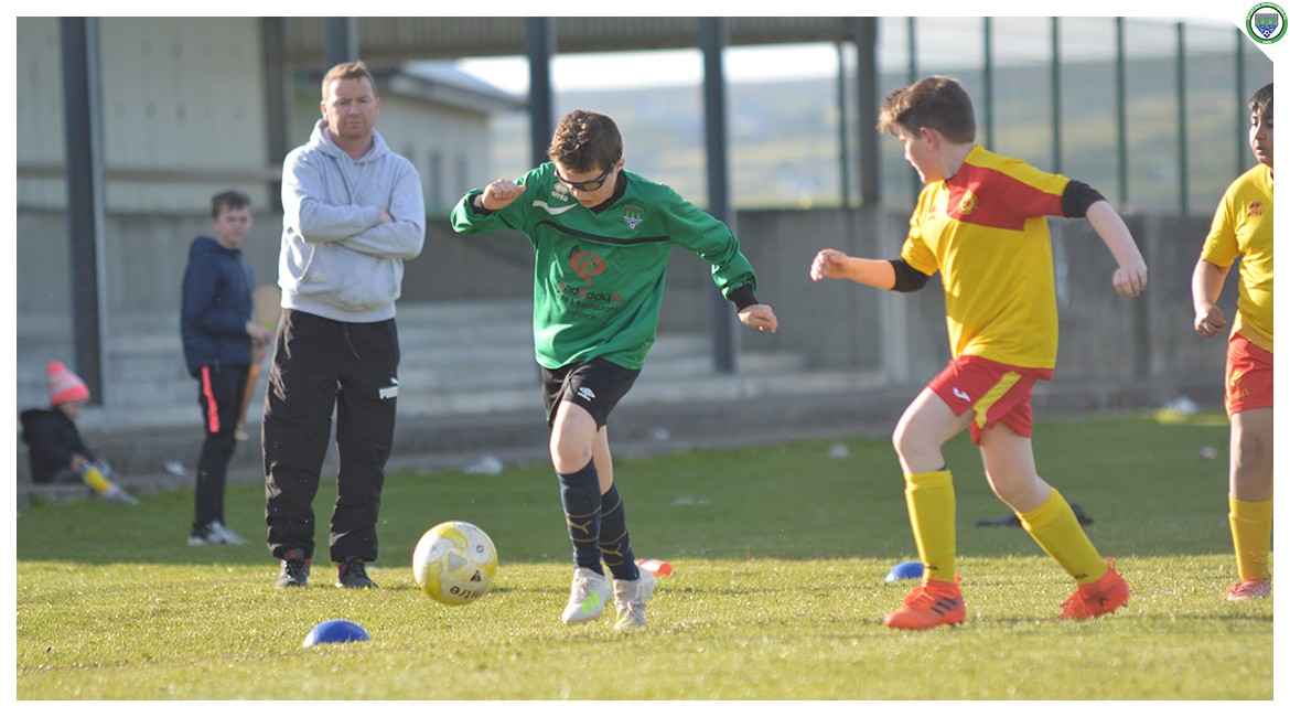 Cian Griffin dribbles up the field in the U12 game between Sporting Ennistymon Football Club and Avenue United Football Club. Game played in Lahinch Sportsfield on the 11th of June 2019.