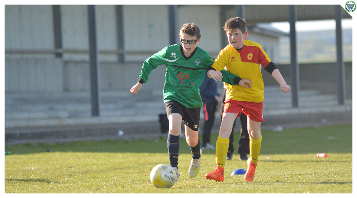 Cian Griffin dribbles past an Avenue United player in the U12 game between Sporting Ennistymon Football Club and Avenue United Football Club. Game played in Lahinch Sportsfield on the 11th of June 2019.
