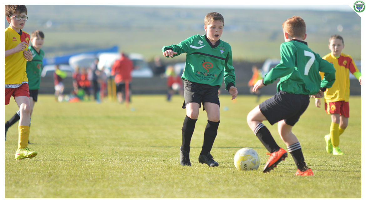 John O'Brien passes the ball to Daniel Brody in the U12 game between Sporting Ennistymon Football Club and Avenue United Football Club. Game played in Lahinch Sportsfield on the 11th of June 2019.
