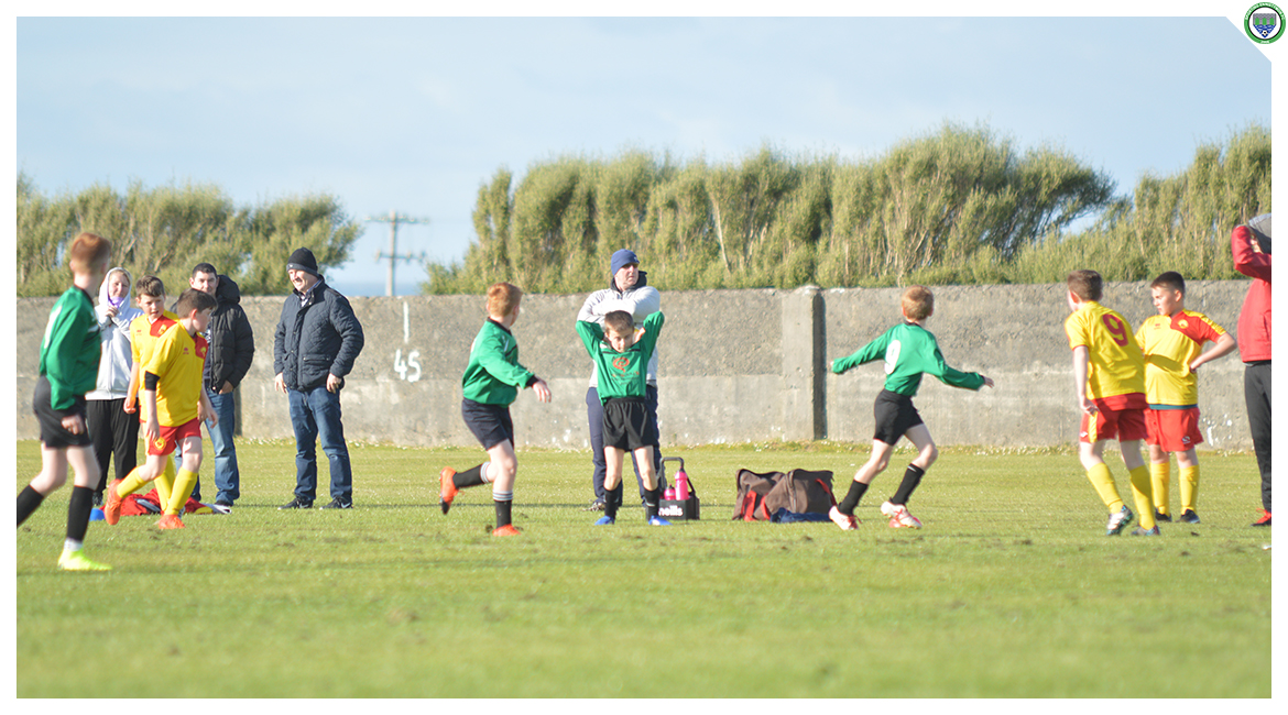 Ultan McDonagh takes a throw-in in the U12 game between Sporting Ennistymon Football Club and Avenue United Football Club. Game played in Lahinch Sportsfield on the 11th of June 2019.