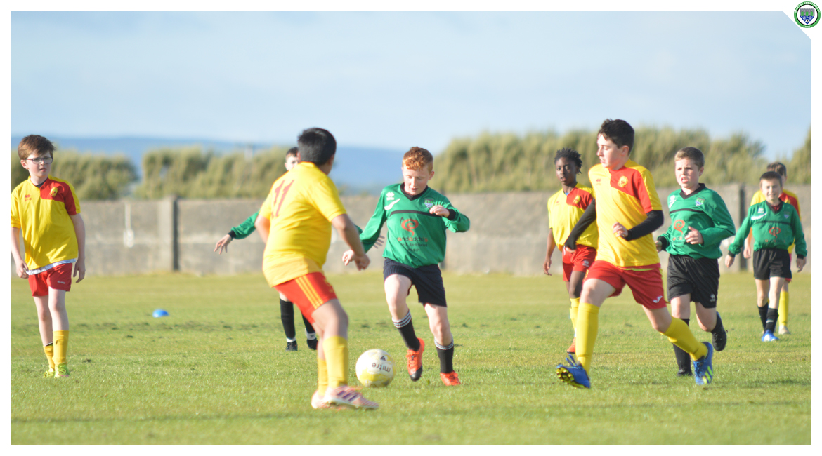 John O'Brien dribbles up the field in the U12 game between Sporting Ennistymon Football Club and Avenue United Football Club. Game played in Lahinch Sportsfield on the 11th of June 2019.
