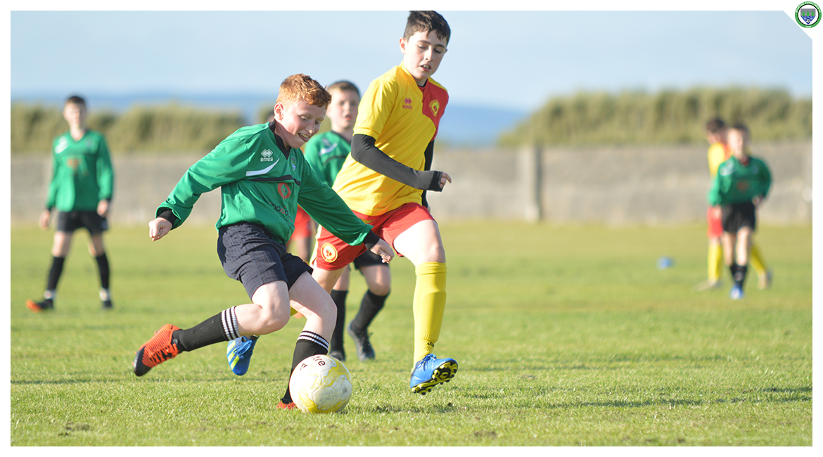 John O'Brien shoots goalward in the U12 game between Sporting Ennistymon Football Club and Avenue United Football Club. Game played in Lahinch Sportsfield on the 11th of June 2019.