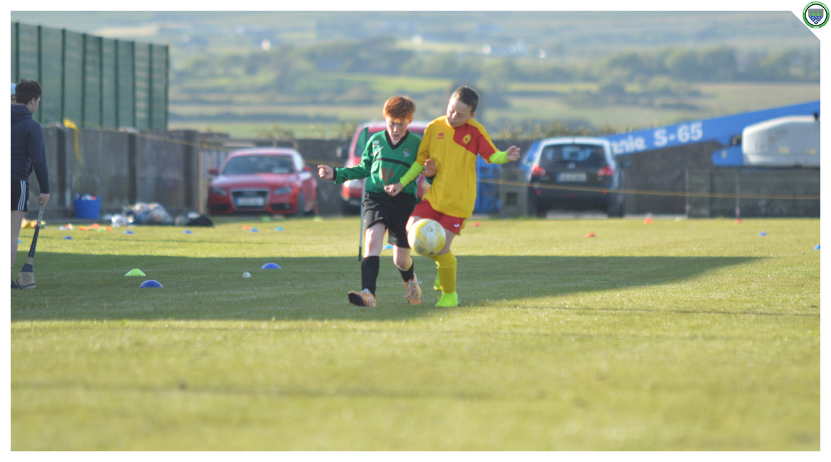 Darragh Cassidy tries to play the ball dow the line while his Avenue United counterpart tries to tackle in the U12 game between Sporting Ennistymon Football Club and Avenue United Football Club. Game played in Lahinch Sportsfield on the 11th of June 2019.