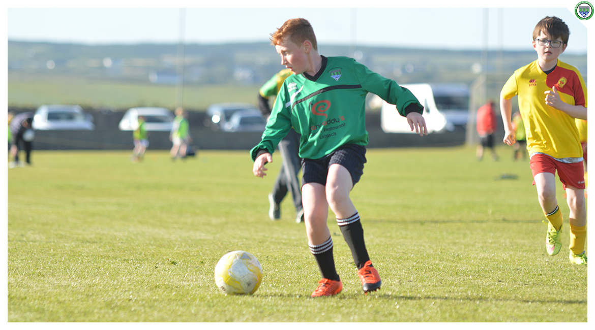 John O'Brien tries to find a pass in the U12 game between Sporting Ennistymon Football Club and Avenue United Football Club. Game played in Lahinch Sportsfield on the 11th of June 2019.