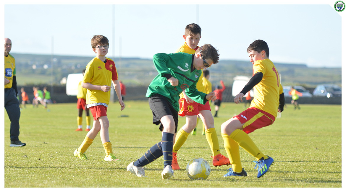 Cian Griffin attempts to beat Avenue United Defenders in the U12 game between Sporting Ennistymon Football Club and Avenue United Football Club. Game played in Lahinch Sportsfield on the 11th of June 2019.