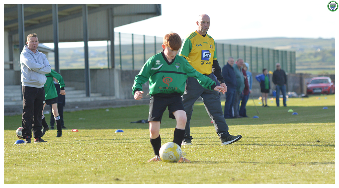 Darragh Cassidy darts in towards goal in the U12 game between Sporting Ennistymon Football Club and Avenue United Football Club. Game played in Lahinch Sportsfield on the 11th of June 2019.