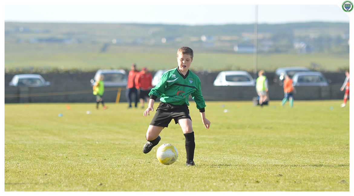 Daniel Brody receiving a pass in the U12 game between Sporting Ennistymon Football Club and Avenue United Football Club. Game played in Lahinch Sportsfield on the 11th of June 2019.