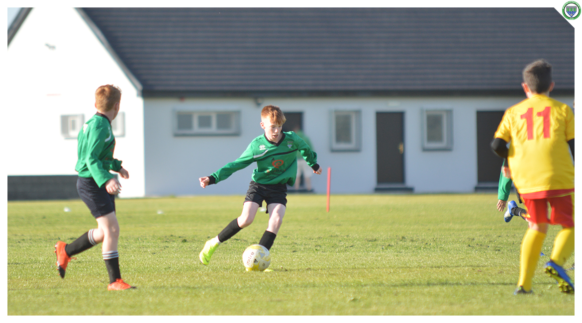 Eoin Devanney playing a pass in the U12 game between Sporting Ennistymon Football Club and Avenue United Football Club. Game played in Lahinch Sportsfield on the 11th of June 2019.