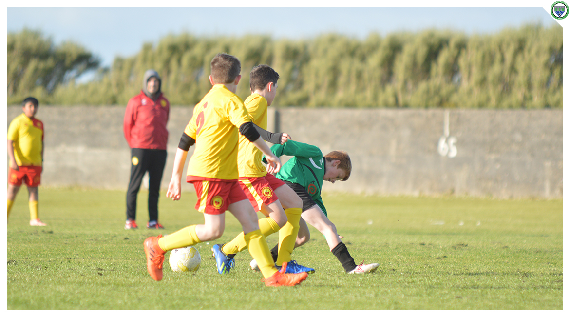 Darren O'Brien is tackled in the U12 game between Sporting Ennistymon Football Club and Avenue United Football Club. Game played in Lahinch Sportsfield on the 11th of June 2019.