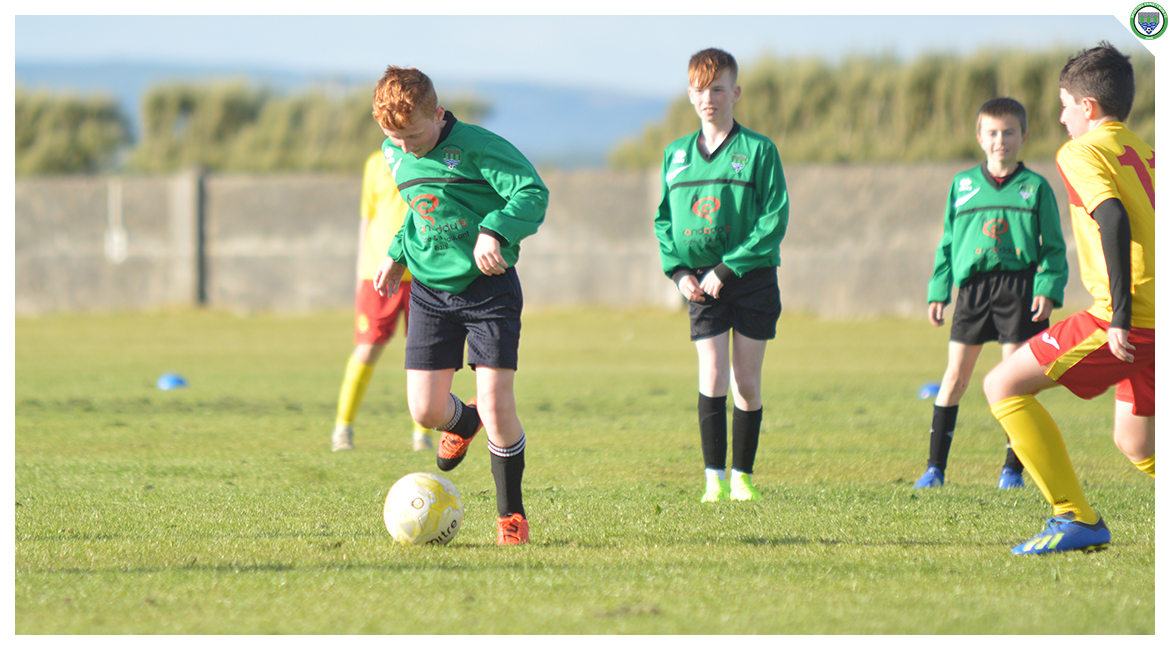 John O'Brien on the attack in the U12 game between Sporting Ennistymon Football Club and Avenue United Football Club. Game played in Lahinch Sportsfield on the 11th of June 2019.